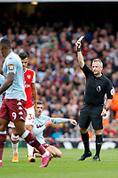 Referee, Jonathan Moss issues a yellow card during the Premier League match between Arsenal and Aston Villa at the Emirates Stadium, London, England on 22 September 2019. Photo by Carlton Myrie / PRiME Media Images.