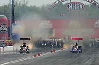 Sept. 1, 2012; Claremont, IN, USA: NHRA top fuel dragster driver Luigi Novelli (left) races alongside Ike Maier during qualifying for the US Nationals at Lucas Oil Raceway. Mandatory Credit: Mark J. Rebilas-