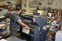 Jim Days prepares a printer at Astro-Dynamic Print & Graphic Thursday August 13, 2015 in Warminster, Pennsylvania. (Photo by William Thomas Cain)
