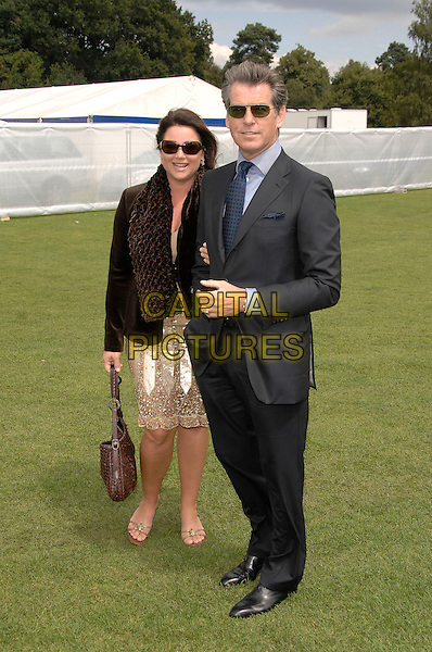 PIERCE BROSNAN, KEELY SHAYE-SMITH.Cartier International Polo at Guards Polo Club, Windsor Great Park, Berkshire, England.29th July 2007  .full length black grey suit blue shirt tie Shaye smith married husband wife couple.CAP/PL.©Phil Loftus/Capital Pictures
