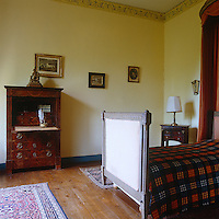 One of several guest bedrooms which are all simply furnished