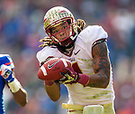 FUS wide receiver Kelvin Benjamin hauls in a fingertip 56 yard reception to set up a Devonta Freeman's touchdown in the 3rd quarter of the #2 ranked Florida State Seminoles 37-7 victory over the Florida Gators at Ben Hill Griffin Stadium in Gainesville, Florida November 30, 2013.  Florida State had an undefeated regular season at 12-0.