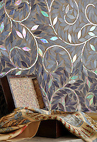 Jacqueline Vine, a jewel glass waterjet mosaic shown in Amethyst, is part of the Silk Road® collection by New Ravenna.