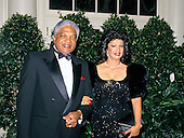 Hugh M. Brown, President and Chief Executive Officer of BAMSI, Inc., and his wife, Ina, arrive at the White House in Washington, DC for the State Dinner honoring President Carlos Menem of Argentina on Thursday, November 14, 1991.<br /> Credit: Ron Sachs / CNP