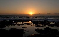 Sun rise over rock pools,Corralejo sand dunes, Fuerteventura, Canary Islands,Spain.
