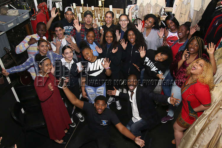 """Justin Dine Bryant with Highschool student performers during a Q & A before The Rockefeller Foundation and The Gilder Lehrman Institute of American History sponsored High School student #eduHam matinee performance of """"Hamilton"""" at the Richard Rodgers Theatre on May 9, 2018 in New York City."""