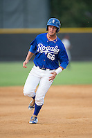 Brandon Thomasson (66) of the Burlington Royals hustles towards third base against the Danville Braves at Burlington Athletic Park on July 12, 2015 in Burlington, North Carolina.  The Royals defeated the Braves 9-3. (Brian Westerholt/Four Seam Images)