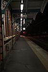 Deserted platform of railway station at night