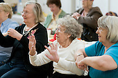 Chair-based exercise session at the weekly over-50s group at Greenside Community Centre, Lisson Green.
