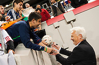 New York Red Bulls head coach Hans Backe signs autographs for fans after the match. The New York Red Bulls and Sporting Kansas City played to a 0-0 tie during a Major League Soccer (MLS) match at Red Bull Arena in Harrison, NJ, on October 20, 2012.