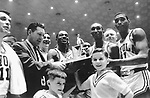 23 MAR 1963:  Loyola coach George Ireland and his team with the James W. St. Clair Memorial Trophy after defeating Cincinnati in the NCAA National Basketball Final Four championship game held in Louisville, KY at Freedom Hall. Loyola defeated Cincinnati 60-58 in over time for the title. Photo by Rich Clarkson