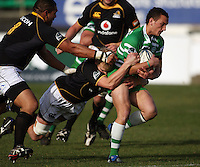 Manawatu first five Aaron Cruden is tackled by Mark Reddish during the Air NZ Cup preseason match between Manawatu Turbos and Wellington Lions at FMG Stadium, Palmerston North, New Zealand on Friday, 17 July 2009. Photo: Dave Lintott / lintottphoto.co.nz
