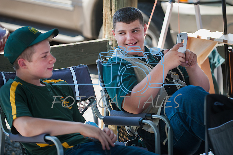 Dalton Wilcox, 15, and Josiah Allred, 15 from the Feather River Claybusters relax during the California Youth Shotgun Shooting Association&rsquo;s championship shootout at the Capitol City Gun Club in Carson City, Nev. on Saturday, May 2, 2015.<br /> Photo by Kevin Clifford/Nevada Photo Source