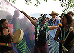 """Margo Thunderbird (at left), an unidentified woman in """"Fish"""" costume, Pete Seeger, and Joanne Shenandoah (right), and others conducting a """"River Blessing"""" Ceremony near the Hudson River Shoreline during the Clearwater's Great Hudson River Revival Music & Environmental Festival 2011 at Croton Point Park, Croton-on-Hudson, NY on Saturday June 18, 2011. Photo copyright Jim Peppler/2011."""