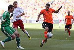 14 JUN 2010: Robin van Persie (NED)(9) receives the ball in the Denmark box as Thomas Sorensen (DEN)(1) defends his goal.  The Netherlands National Team defeated the Denmark National Team 2-0 at Soccer City Stadium in Johannesburg, South Africa in a 2010 FIFA World Cup Group E match.