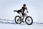 DEADWOOD, SD - JANUARY 23, 2016 -- Josh Bruhn #139 of Rapid City, S.D. dismounts his fat-tire bike in some soft snow on a warm day at the 2016 Snow Jam Points Series at Tomahawk Country Club south of Deadwood, S.D. Saturday. (Photo by Richard Carlson/dakotapress.org)