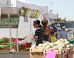 The Workman Farms booth offer fresh vegetables at the 2008 Cantaloupe  Festival.  Photo by Tom Smedes.