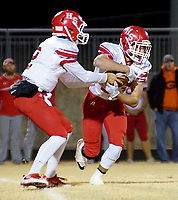 NWA DEMOCRAT-GAZETTE/RANDY MOLL<br /> Heber Springs' sophmore quarterback, Adam Martin, hands off the ball to Blaze Nelson, a junior from Heber Springs, during their opening playoff game at Gravette on Friday, Nov. 10, 2017.