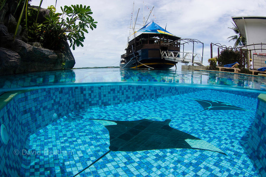 This split image shows the pool and the ship/restaurant named The S/V Mnuw (Sea Hawk) at the Manta Ray Bay Hotel on the island of Yap, Micronesia.