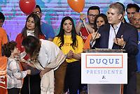 BOGOTA - COLOMBIA, 27-05-2018: Maria Juliana Ruiz y Matías esposa e hijo de Ivan Duque, candidato presidencial por le partido Centro Democrático durante la alocución de este último después de salir ganador en la jornada electoral hoy, 27 de mayo de 2018. Las elecciones presidenciales de Colombia de 2018 se celebrarán el domingo 27 de mayo de 2018. El candidato ganador gobernará por un periodo máximo de 4 años fijado entre el 7 de agosto de 2018 y el 7 de agosto de 2022. /Maria Juliana Ruiz and Matías wife and children of Ivan Duque, presidential candidate for the Centro Democratico party, during his speech after winning on election day today, May 27, 2018. Colombia's 2018 presidential election will be held on Sunday, May 27, 2018. The winning candidate will govern for a maximum period of 4 years fixed between August 7, 2018 and August 7, 2022.. Photo: VizzorImage / Gabriel Aponte / Staff