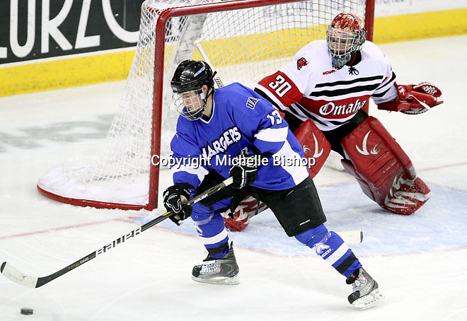 UNO goalie John Faulkner keeps an eye on Alabama-Huntsville's Joey Koudys. Alabama-Huntsville beat UNO 2-1 in overtime Saturday night at Qwest Center Omaha. (Photo by Michelle Bishop)