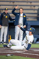 Michigan Wolverines first baseman Jimmy Kerr (15) scores a run against the San Jose State Spartans on March 27, 2019 in Game 2 of the NCAA baseball doubleheader at Ray Fisher Stadium in Ann Arbor, Michigan. Michigan defeated San Jose State 3-0. (Andrew Woolley/Four Seam Images)