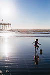 Ruthawna Collins, 4, of Forsyth, Missouri, plays along the shore of Pismo Beach, California December 22, 2014. The trip was her first trip to the beach.