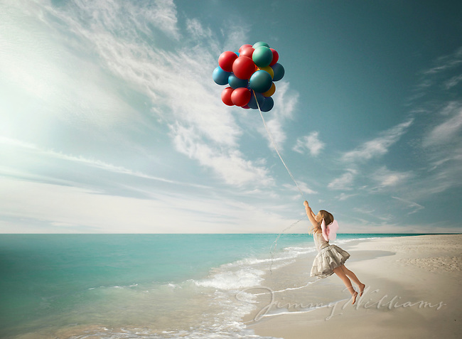 A girl being pulled away by balloons.