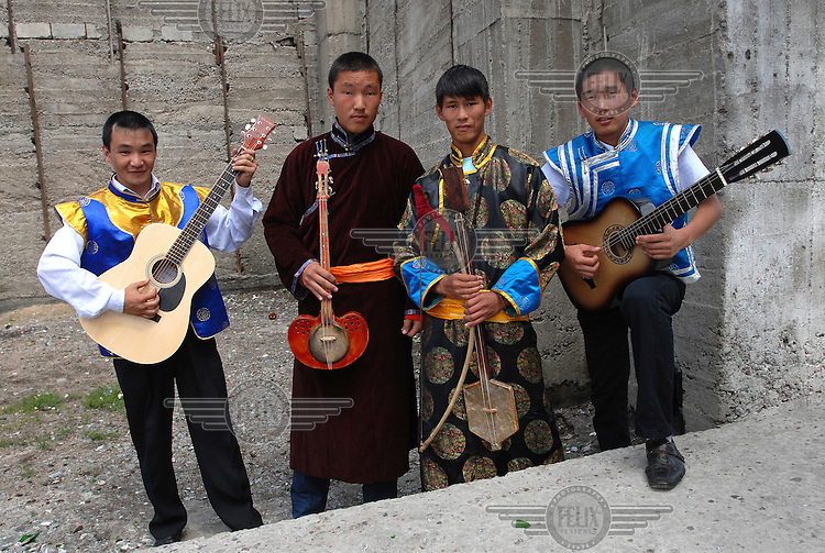 Four musicians at festivities for the Tuvan Naadym (New Year) holiday at this isolated border post at the southern-most extremity of Russian territory.