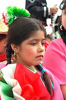Girl age 5 wearing ethnic clothing at Cinco De Mayo Festival Parade.  St Paul  Minnesota USA