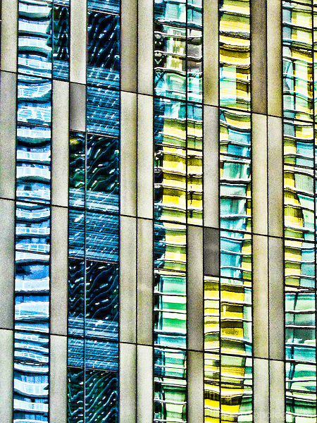 Abstraction of reflection captured on side of a building.