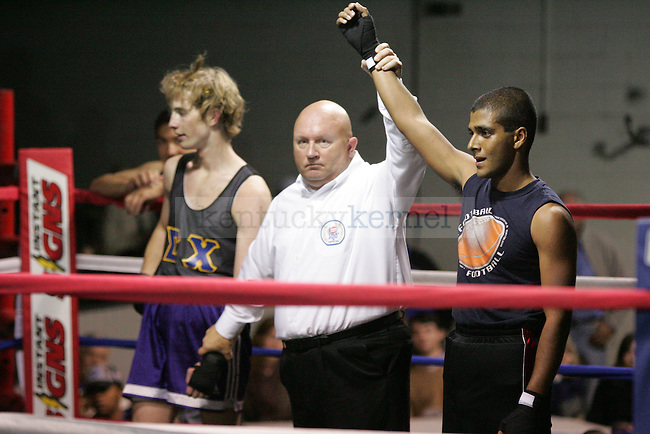 Rick Guha (R) of Phi Sig wins his bout against Charlie Hunt (L) of Sigma Chi at The Main Event, where proceeds benefitted The Huntsman Cancer Institute and The Ronald McDonald House in Lexington, Ky. on 11/11/11. Photo by Quianna Lige | Staff