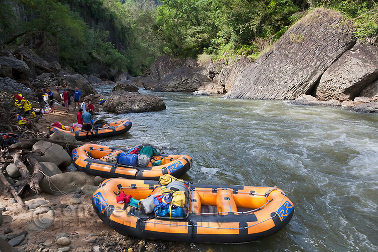 Rafts on riverbank during white-water rafting expedition on North Johnstone River.  Wooroonoonan National Park, Queensland, Australia
