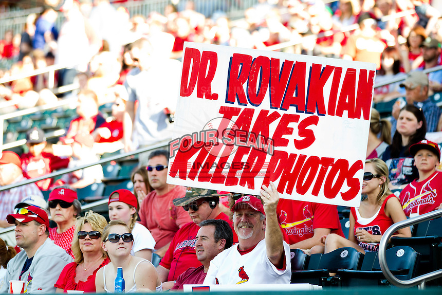 "Marty ""The Sign Man"" holds up a sign directed at the St. Louis Cardinals team photographer prior to a game between the St. Louis Cardinals and the Springfield Cardinals at Hammons Field on April 2, 2012 in Springfield, Missouri. (David Welker/Four Seam Images)"