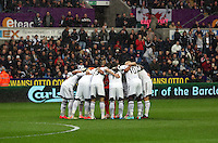 Sunday, 26 April 2014<br /> Pictured: Swansea players huddle before kick off.<br /> Re: Barclay's Premier League, Swansea City FC v Aston Villa at the Liberty Stadium, south Wales.