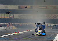 Feb 9, 2014; Pomona, CA, USA; NHRA top fuel dragster driver Sidnei Frigo blows a tire after he explodes an engine during the Winternationals at Auto Club Raceway at Pomona. Mandatory Credit: Mark J. Rebilas-