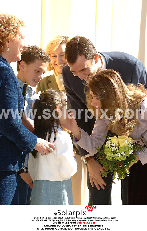 """ALL ROUND PICTURES FROM SOLARPIX.COM..Prince Felipe and Princess Letizia of Spain attend the """"Empresas & Sociedad"""" Foundation Awards Ceremony in Madrid on 15.03.06.  The Princess was greeted by children from a local blind school who asked if they could touch her face so that they would be able to see how beautiful she is..Princess Letizia wore understated white gold and diamond jewellery including a charm bracelet which incorporated the name of her daughter Leonor.  Job Ref: 2191/SPA..MUST CREDIT SOLARPIX.COM OR DOUBLE FEE WILL BE CHARGED...."""