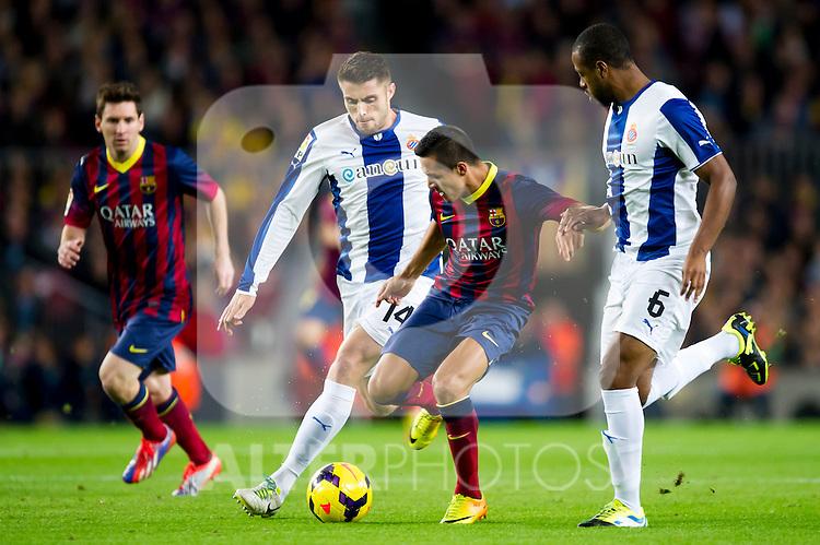 FC Barcelona's Alexis Sanchez (center) and RCD Espanyol's David Lopez (left) and Sidnei Rechel Da Silva Junior (right) during La Liga 2013-2014 match. November 1, 2013. (ALTERPHOTOS/Alex Caparros)