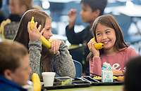 NWA Democrat-Gazette/BEN GOFF @NWABENGOFF<br /> Alison Tennyson (left) and Aubrey Standard, both 4th graders, pretend their bananas are telephones Wednesday, Oct. 17, 2018, during lunch at Janie Darr Elementary School in Rogers. Rogers Public Schools administrators visited the school for lunch as part of the district's recognition of National School Lunch Week. The district's schools serve 11,000 meals each day, according to Ashley Siwiec, communications director for the district.