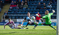Garry Thompson of Wycombe Wanderers hits a shot at goal during the Sky Bet League 2 match between Wycombe Wanderers and Barnet at Adams Park, High Wycombe, England on 16 April 2016. Photo by Andy Rowland.