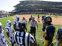 California captians' Bryan Anger, Ernest Owusu, Will Kapp and Sean Cattouse and Presbyterian captians watch referee Jay Stricherz tosses a coin during coin toss ceremony before the game at AT&T Park in San Francisco on September 17th, 2011.  California defeated Presbyterian, 63-12.