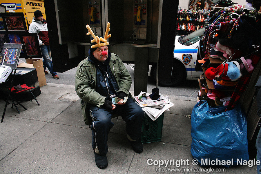 NEW YORK - DECEMEBER 21, 2007:  Street vendor James Kushner dresses as rudolph the red-nosed reindeer to sttract holiday shoppers on Fifth Avenue on December 21, 2007 in New York City.  (PHOTOGRAPH BY MICHAEL NAGLE)