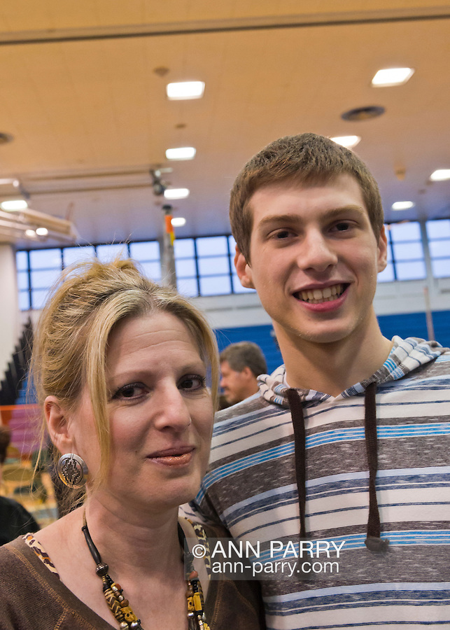 SANDRA BROWNWORTH is with her son DEAN BROWNWORTH, 17, a cancer survivor who's the headliner at St. Baldrick's head shaving event at Calhoun High School, where he's a senior. The school exceeded its goal of raising $50,000 for childhood cancer research. Plus, many ponytails cut off will be donated to Locks of Love foundation, which collects hair donations to make wigs for children who lost their hair due to medical reasons.