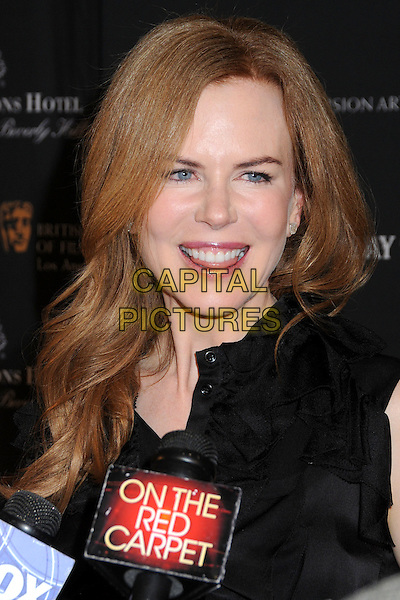 NICOLE KIDMAN .17th Annual BAFTA Los Angeles Awards Season Tea Party held at the Four Seasons Hotel, Beverly Hills, California, USA, 15th January 2011..portrait headshot black shirt mouth open microphone interview smiling .CAP/ADM/BP.©Byron Purvis/AdMedia/Capital Pictures.