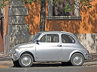 Left side view of a metallic silver 1970's Fiat 500 L city car.