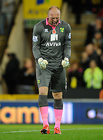 Norwich City Goalkeeper John Ruddy celebrates his sides goal, 1-0, during the Barclays Premier League match between Norwich City and Swansea City played at Carrow Road, Norwich on November 7th 2015