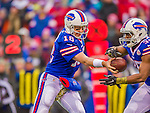 9 November 2014: Buffalo Bills quarterback Kyle Orton makes a hand-off to running back Bryce Brown against the Kansas City Chiefs at Ralph Wilson Stadium in Orchard Park, NY. The Chiefs rallied with two fourth quarter touchdowns to defeat the Bills 17-13. Mandatory Credit: Ed Wolfstein Photo *** RAW (NEF) Image File Available ***