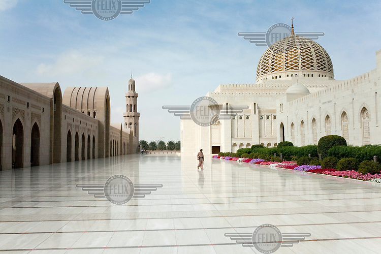 A security guard walks through the courtyard of the Sultan Qaboo's Grand Mosque in Muscat.