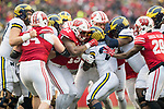 Wisconsin Badgers defense stops Michigan Wolverines running back Karan Higdon (22) during an NCAA College Big Ten Conference football gameSaturday, November 18, 2017, in Madison, Wis. The Badgers won 24-10. (Photo by David Stluka)