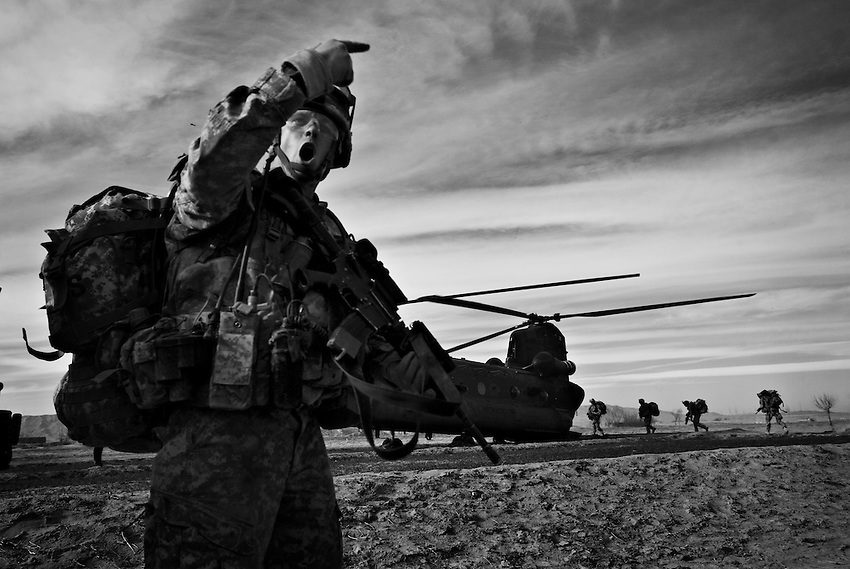 Sgt. 1st Class Jeremy Wilcox, 1/506th Infantry, leads Baker Company to a Chinook helicopter for extraction after a clearing operation in Gabikhel, Paktika Province, Afghanistan, Sunday, Feb. 15, 2009.